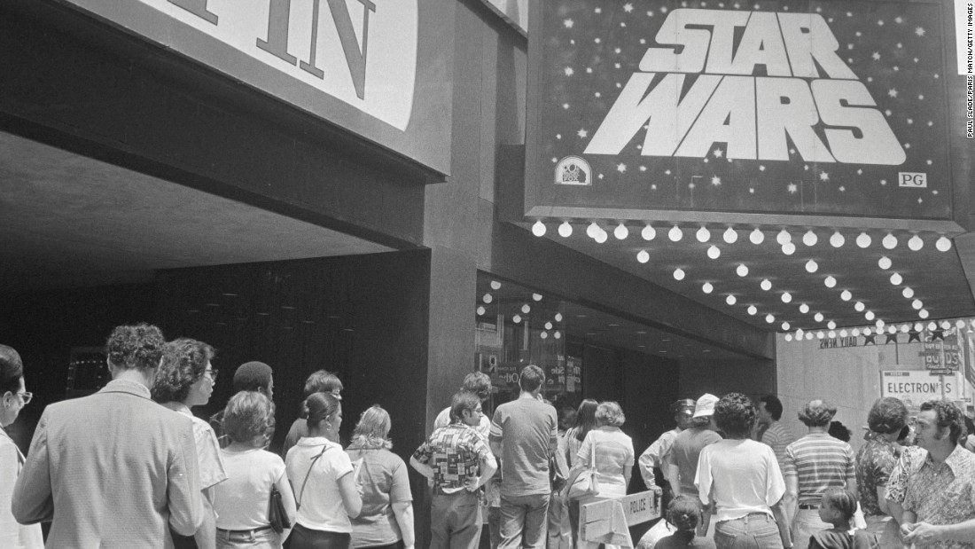 """Star Wars"" was a phenomenon upon release in May 1977, with lines around the block (in the days when theaters were largely located on city blocks). Here, people line up in New York to see the film, which soon became the highest-grossing film of all time -- a record it held until ""E.T."" took its place five years later."