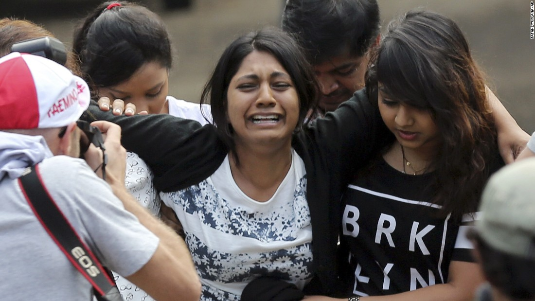 Brintha Sukumaran, center, sister of death row prisoner Myuran Sukumaran, cries upon arrival at the ferry port in Cilacap on April 28.
