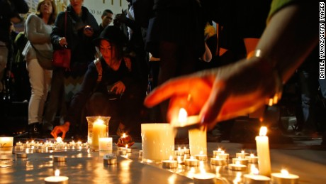 SYDNEY, AUSTRALIA - APRIL 28: A woman lits a candle for the prisoners to be executed in Indonesia, during a vigil at Martin Place on April 28, 2015 in Sydney, Australia. Supporters of Bali Nine duo Andrew Chan and Myuran Sukumaran held a vigil tonight as the pair prepare to face the firing squad this evening at Indonesia's Nusakambangan Island. Chan and Sukumaran were both sentenced to death after being found guilty of attempting to smuggle 8.3kg of heroin valued at around $4 million from Indonesia to Australia along with 7 other accomplices. (Photo by Daniel Munoz/Getty Images)