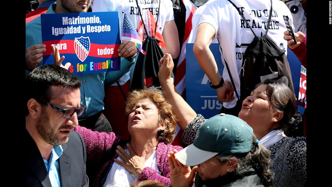 "A group against same-sex marriage prays in an ""appeal to heaven"" outside the Supreme Court."
