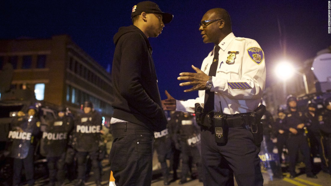 A Baltimore police captain tries to calm a protester on April 28.