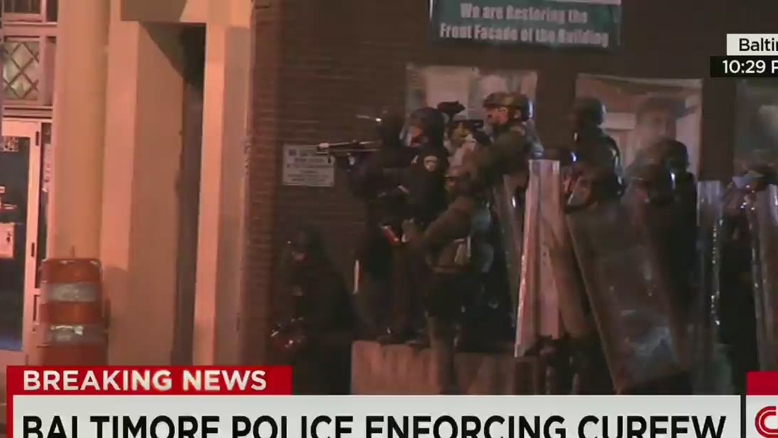 Baltimore protests: Crowds, police stand off after curfew