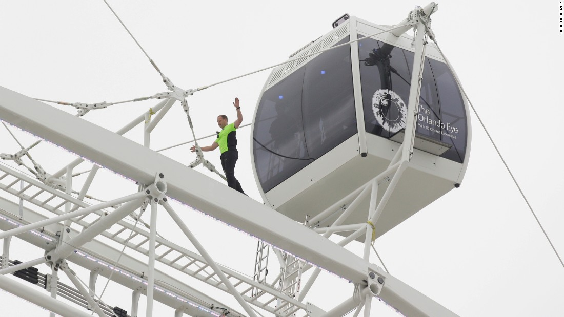 Daredevil performer Nik Wallenda walks untethered along the rim of the Orlando Eye, the Florida city's new 400-foot observation wheel, in April 2015. Click through the gallery for other Wallenda stunts through the years.