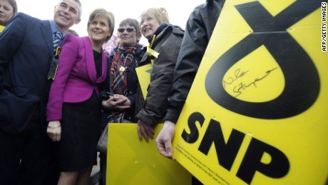 First Minister of Scotland and leader of the SNP Nicola Sturgeon (2L) poses with supporters during a UK general election campaign visit to the Cook School in Kilmarnock, Ayrshire, southwest Scotland on April 27, 2015. Britain goes to the polls on May 7 to elect a new parliamnt. SNP leader Nicola Sturgeon, whose party is expected to win most of Scotland's House of Commons seats amid surging support after last year's rejected independence referendum, wants to do a post-election deal with Labour. AFP PHOTO / ANDY BUCHANANAndy Buchanan/AFP/Getty Images