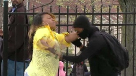 Baltimore mom who slapped son: 'Put that brick down!'