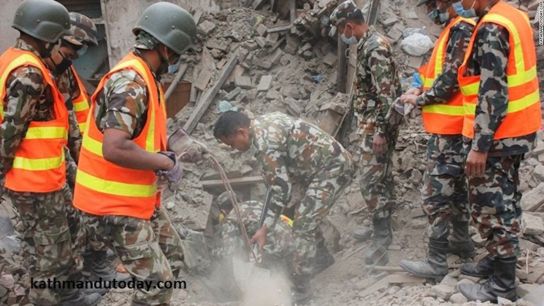 Nepali soldiers seen digging in debris of the Awal's collapsed home.