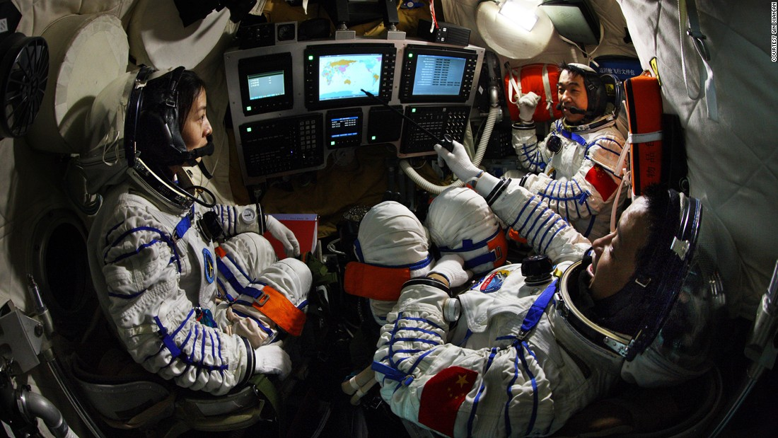 Nie, Zhang and Wang discuss technical issues  during training in April 2012, a year before the 15-day mission.