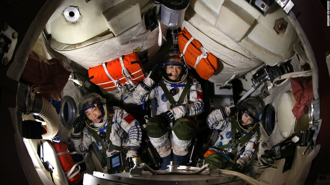 Zhang, left, Nie, center, and Wang, right,  during a training session in the return capsule.