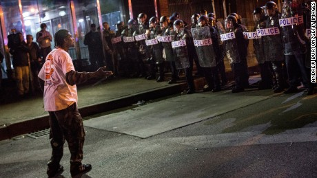 Caption:BALTIMORE, MD - APRIL 30: People protesting the death of Freddie Gray and demanding police accountability move into the streets in the Sandtown neighborhood where Gray was arrested on April 30, 2015 in Baltimore, Maryland. Gray, 25, was arrested for possessing a switch blade knife April 12 outside the Gilmor Houses housing project on Baltimore's west side. According to his attorney, Gray died a week later in the hospital from a severe spinal cord injury he received while in police custody. (Photo by Andrew Burton/Getty Images)
