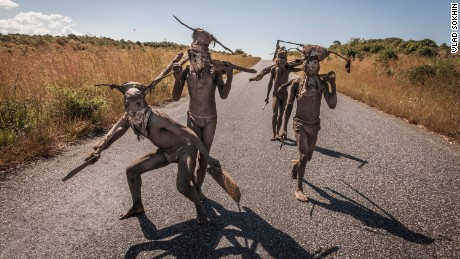 "I had no idea what Nyau was, so I started to do some research. I learned it was a secret society within the Chewa culture. Chewa people live in Malawi, Zambia and Mozambique. I found out that many locals, and even policemen, were afraid of the Nyau and considered them dangerous. One type of Nyau, known as Nyau ""kampini,"" or ""dangerous Nyau,"" (pictured) walk around with machetes and have a reputation for attacking people."