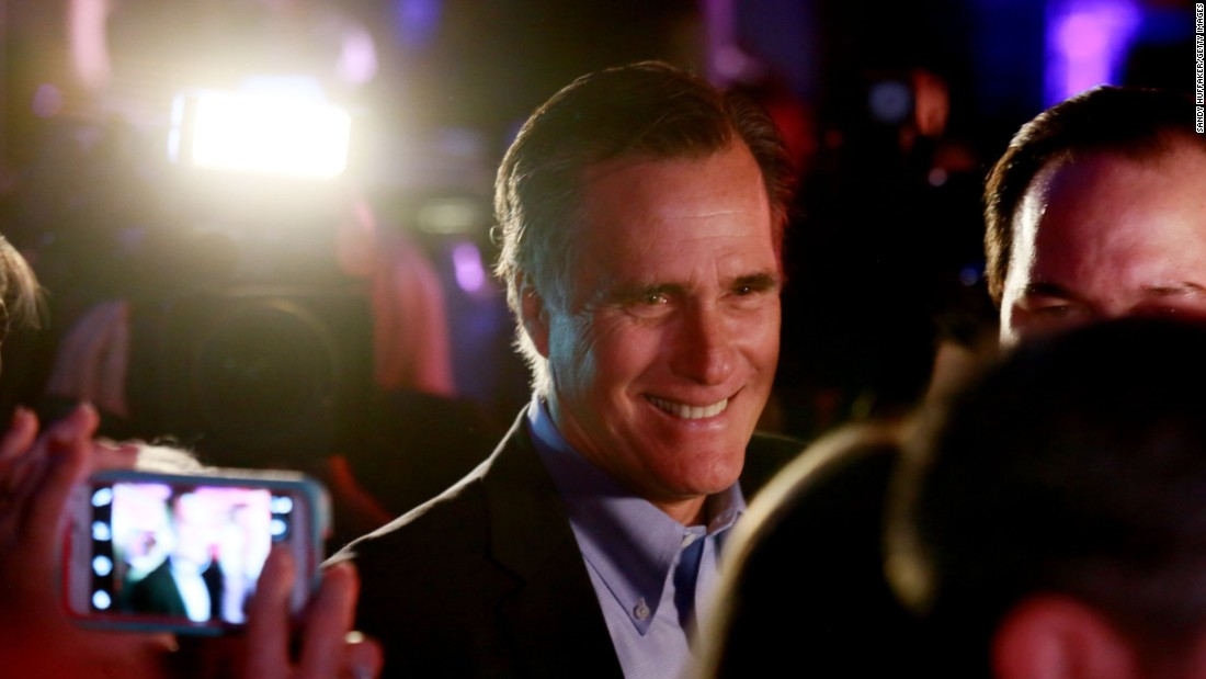 Former GOP presidential nominee Mitt Romney is pictured greeting fellow Republicans at a dinner during the RNC Annual Winter Meeting aboard the USS Midway on January 16 in San Diego. During Romney's 2012 presidential campaign, the Koch brothers hosted a fundraiser where the tickets reportedly were $50,000 each.