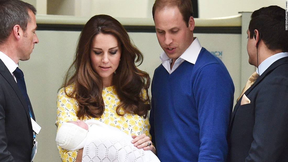William and Catherine present their newborn daughter as they leave a London hospital in May 2015.