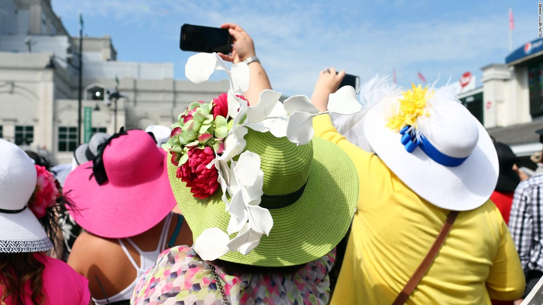Bright colors rule the day for spectators watching the paddock area prior to the Derby.