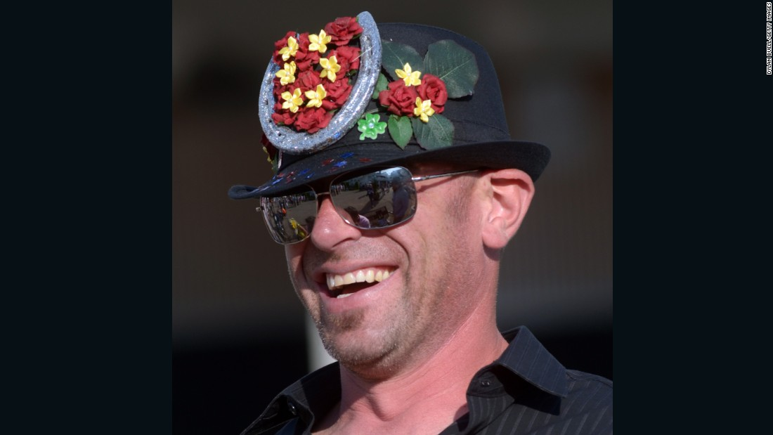 Fake flowers and a horseshoe came in handy when customizing this hat. Men often wear styles reminiscent of the 1920s.