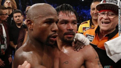 Floyd Mayweather Jr., left, hugs Manny Pacquiao after defeating him in their welterweight unification bout.