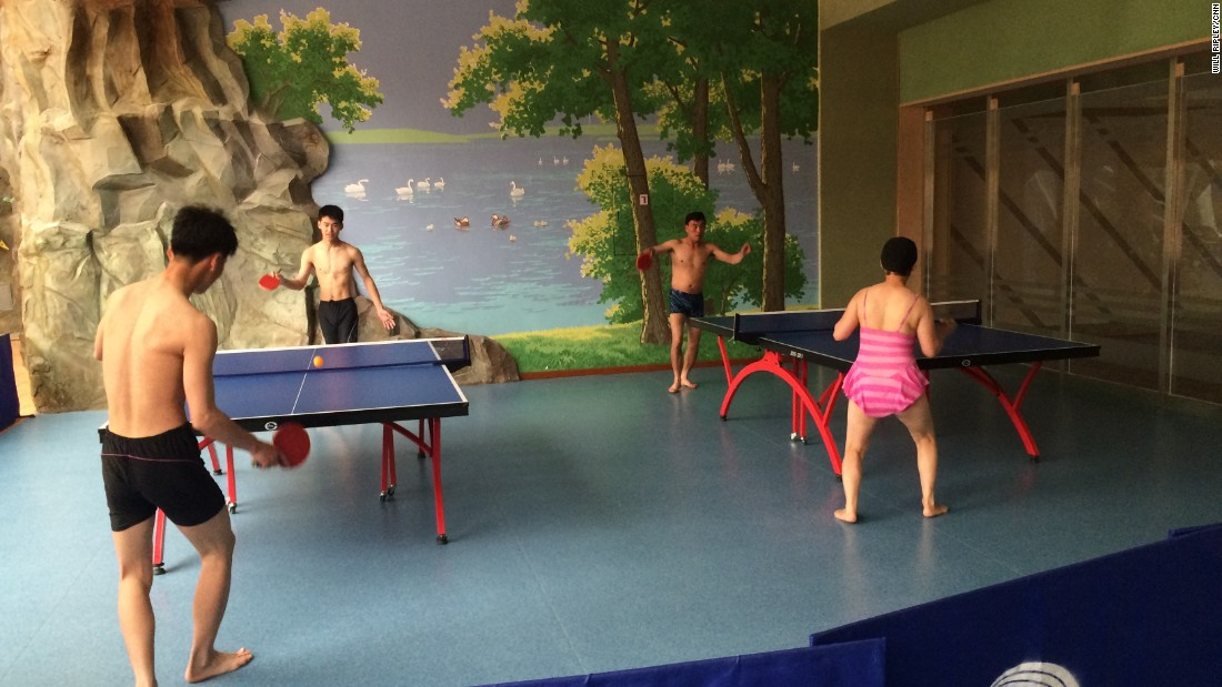 Visitors to a Pyongyang water park play table tennis.