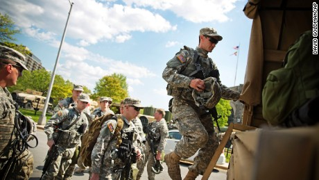 Members of the National Guard board a truck at an armory staging area Sunday, May 3, 2015, in Baltimore. after Baltimore's mayor lifted a citywide curfew.