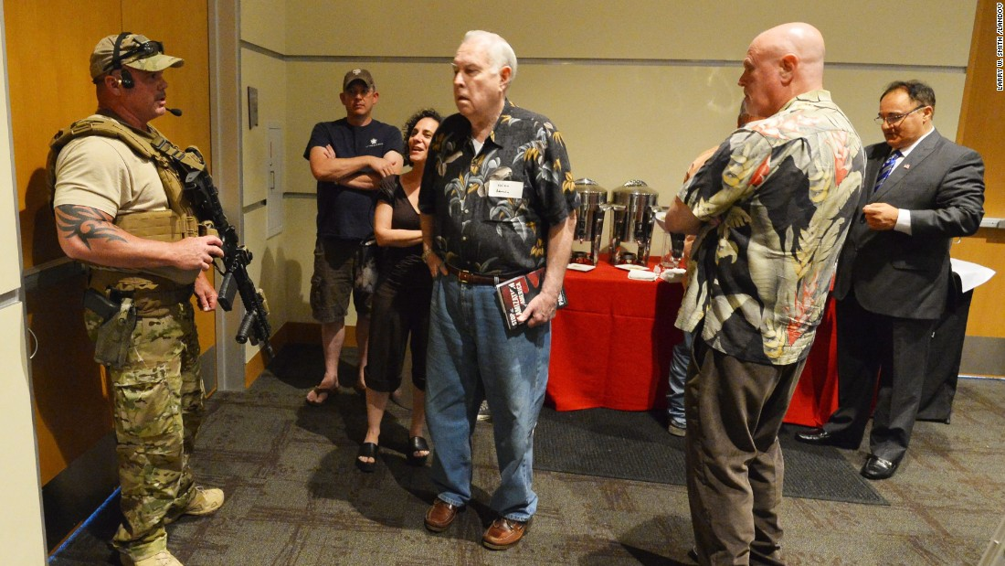 A member of the Garland Police Department keeps members of the audience inside the Curtis Culwell Center in Garland, Texas, after reports of shots fired outside. Two men were shot outside the event, called the Muhammad Art Exhibit and Cartoon Contest. The exhibit was sponsored by the American Freedom Defense Initiative.