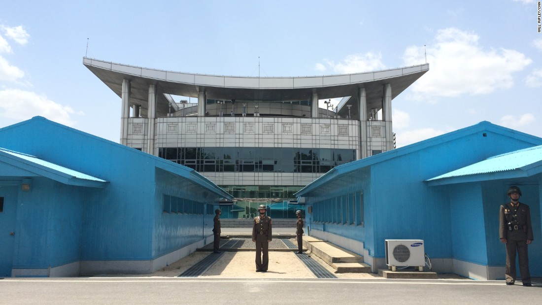 The view from the North Korean side of the DMZ, with armed DPRK soldiers standing guard.