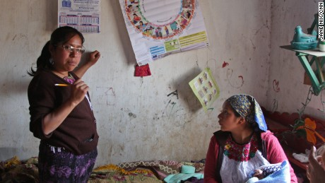 Health worker Aura Fuentes uses an illustrated wheel to help Mauricia keep track of her progress.