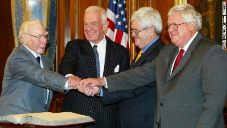Speaker of the House Dennis Hastert (R) (R-IL) joins former speakers of the House (L-R) James Wright Jr. (D-TX), Thomas Foley (D-WA) and Newt Gingrich (R-GA) in a four-way handshake during a meeting on Capitol Hill November 12, 2003 in Washington, DC. The speakers were on Capitol Hill to participate an event on the changing nature of the U.S. House of Representatives speakership. (Photo by Alex Wong/Getty Images)