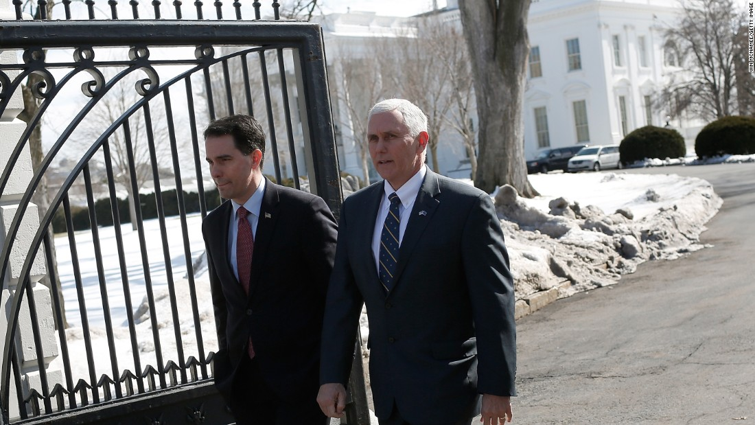 Wisconsin Gov. Scott Walker, left, and Pence depart the White House after President Obama addressed members of the National Governors Association on February 23 in Washington.