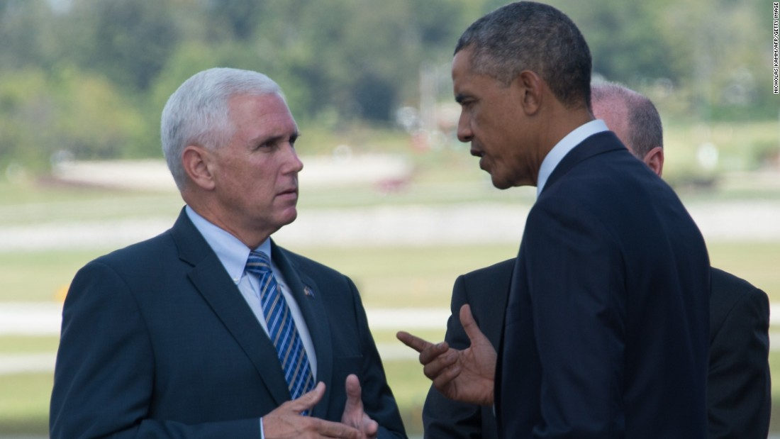 Pence and President Obama chat at Evansville Regional Airport in Indiana on Obama's arrival on October 3, 2014, to discuss investments in American manufacturing.