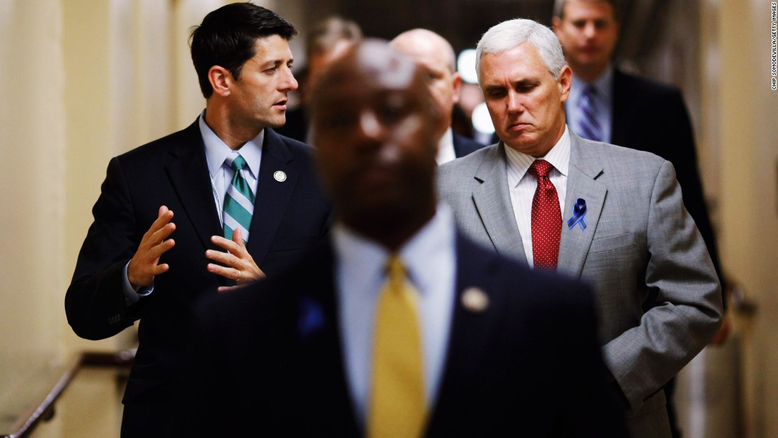 Rep. Paul Ryan of Wisconsin, left, talks with Pence, then a congressman, as they head to a Republican conference meeting at the U.S. Capitol on July 25, 2011.