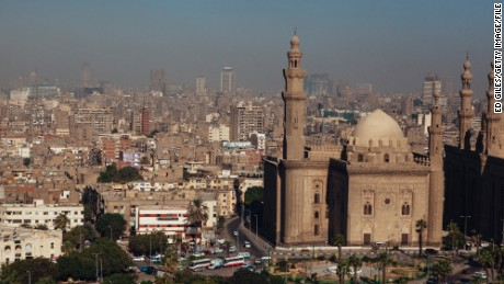 The Sultan Hassan Mosque and city skyline of Cairo are seen from the Muhammad Ali Mosque in Cairo's Citadel on October 21, 2013 in Cairo, Egypt.