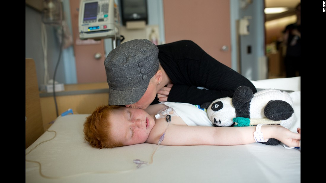 Colin gets a kiss on the cheek as he wakes up from a medical procedure in October. He goes to Winnipeg once a month for chemotherapy treatment, and he must undergo a lumbar puncture every three months to confirm the cancer hasn't spread to his spinal fluid or brain.