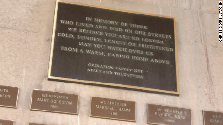 A plaque under a Pittsburgh highway commemorates the homeless men and women who have died.
