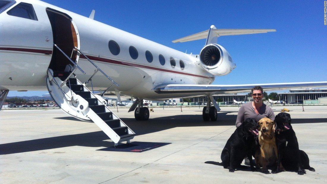 Celebrity Stylist Chaz Dean prepares to board a Gulfstream G-IV with his Labradors.