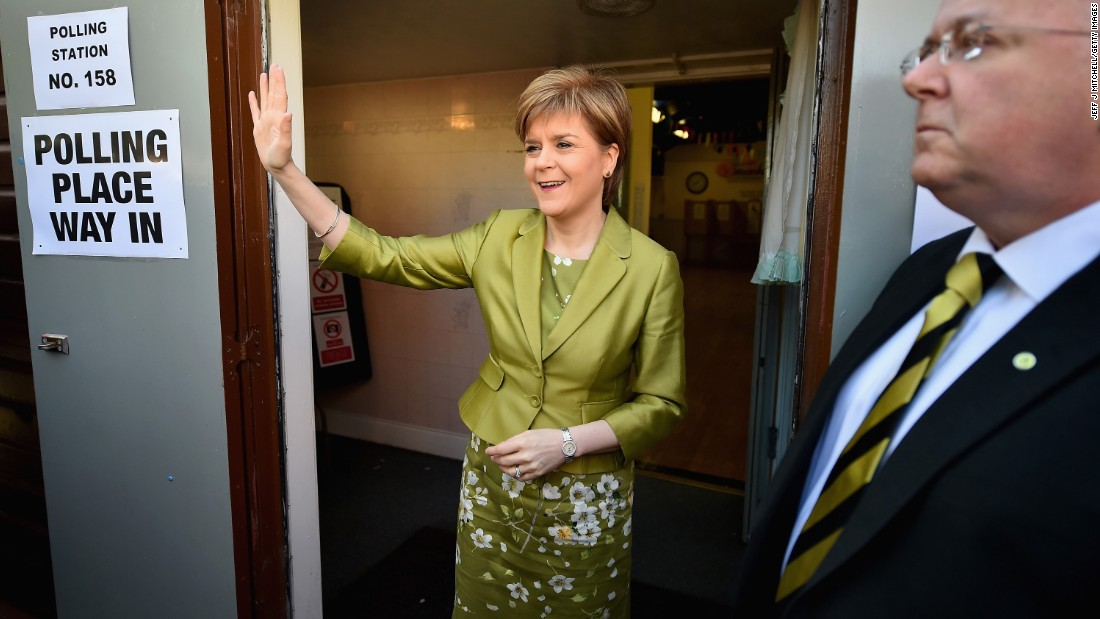 Nicola Sturgeon, first minister of Scotland and leader of the Scottish National Party, votes with her husband, Peter Murrell, in Glasgow, Scotland.