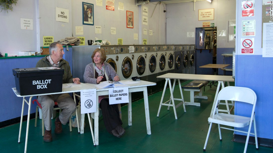 Election officials operate a polling station inside a laundromat in Oxford, England.
