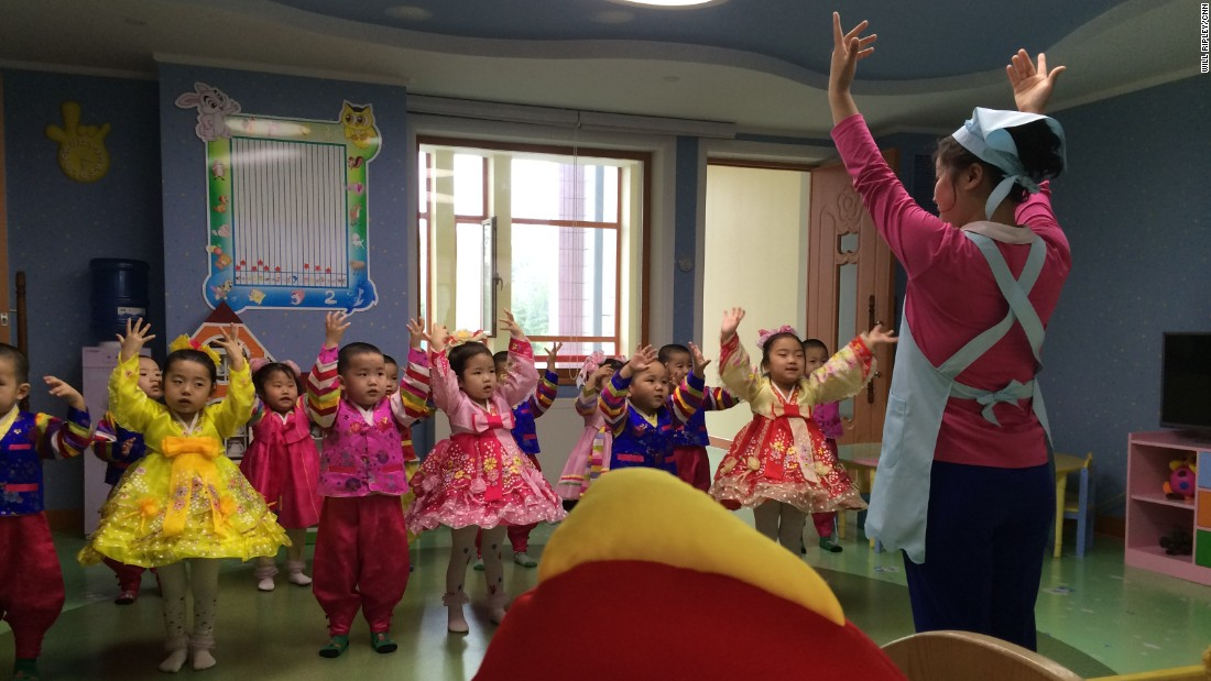 Young children in a newly constructed Pyongyang orphanage practice a musical performance.