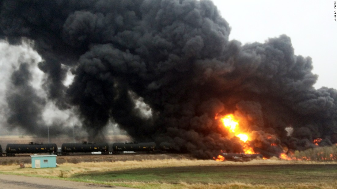 Fire and smoke spew from an oil train that derailed in Heimdal, North Dakota, on Wednesday, May 6.