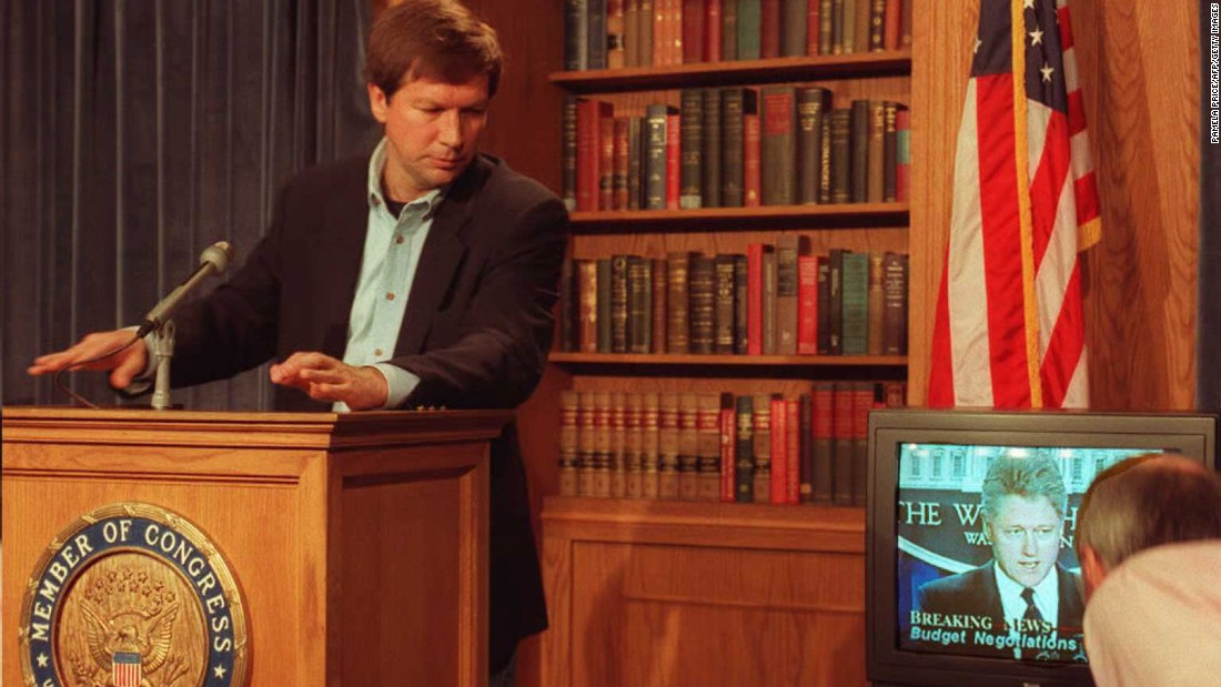 Kasich shows a videotape of President Bill Clinton speaking during a news conference on Capitol Hill on December 16, 1995. Kasich was chairman of the House Budget Committee at the time and disputed Clinton's position on the budget.