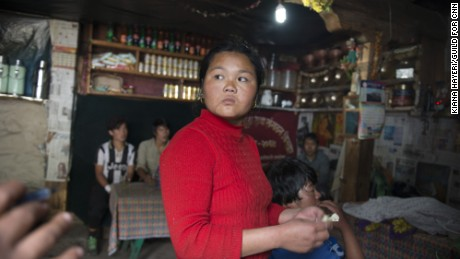 A woman who runs a small restaurant has few customers. Sherpas who serve the tourist community are hurting after two failed Everest climbing seasons.