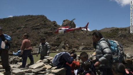 Helicopters usually ferry climbers to Everest Base Camp. This year, they have been carrying those who died or were injured in the quake back to lower ground.