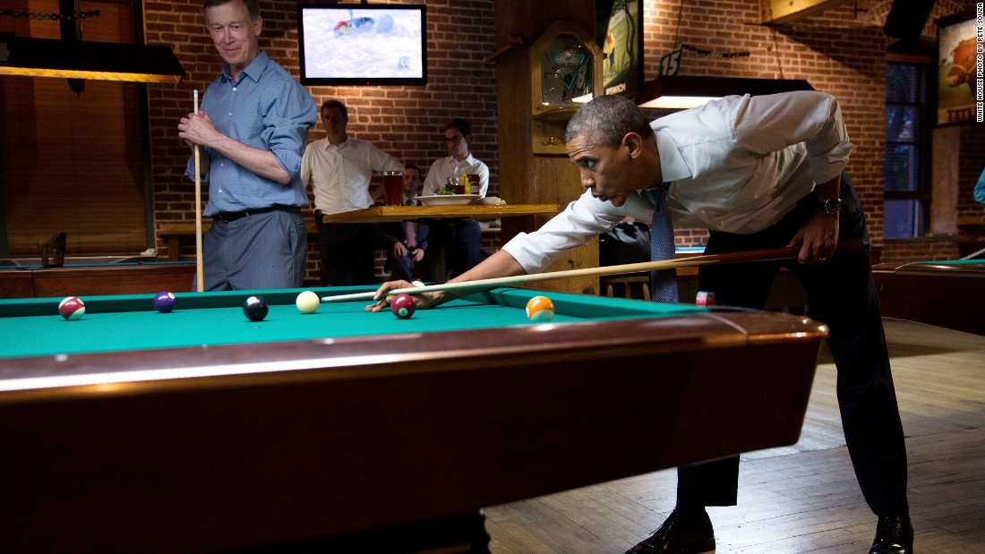Playing pool with Gov. John Hickenlooper in Denver, Colorado, on July 8, 2014.