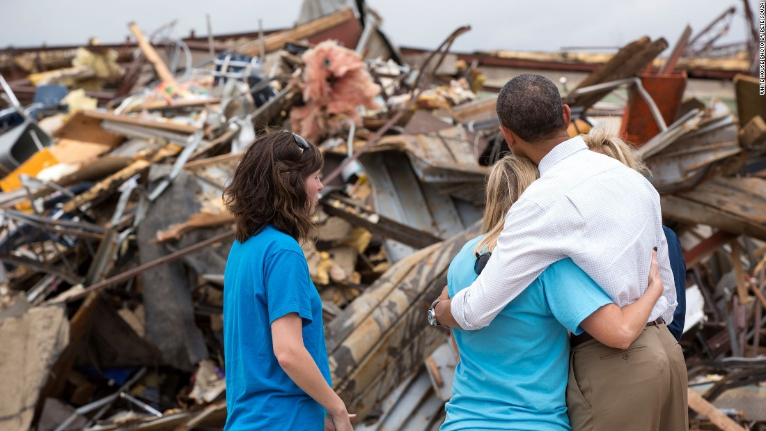 Hugging Amy Simpson, principal of Plaza Towers Elementary School, while viewing the remains of the school after a tornado in Moore, Oklahoma, on May 26, 2013.