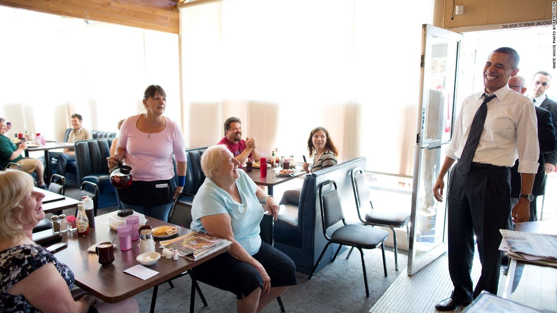 Reacting to a quip from a patron at the Gateway Breakfast House in Portland, Oregon, on July 24, 2012.