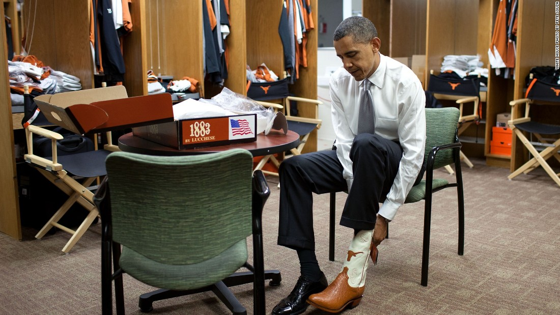 Trying on a pair of cowboy boots at the University of Texas in Austin on August 9, 2010.