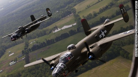 Two B-25 Mitchell bombers fly in formation with dozens of other World War II era aircraft over Culpeper Regional Airport in Brandy Station, Virginia, May 7, 2015. Dozens of World War II era planes will fly past the National Mall in Washington, DC, on May 8, during the Arsenal of Democracy World War II Victory Capitol Flyover to commemorate the 70th anniversary of Victory in Europe (VE) Day. AFP PHOTO / ANDREW CABALLERO-REYNOLDSAndrew Caballero-Reynolds/AFP/Getty Images