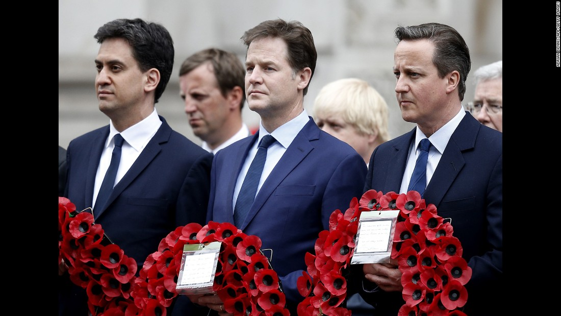 British Prime Minister David Cameron, right, attends a V-E Day service at the Cenotaph in London. Next to Cameron is outgoing Liberal Democratic Party leader Nick Clegg, center. Outgoing Labour Party leader Ed Miliband is at far left.