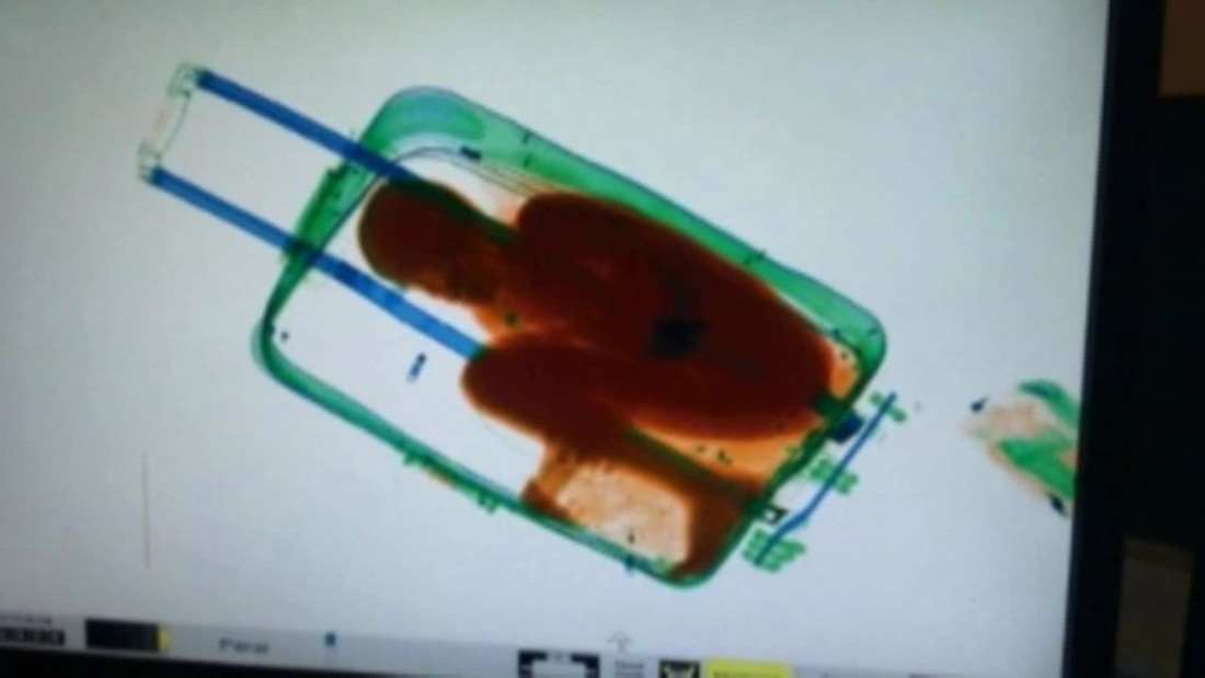 8-year-old boy smuggled in suitcase