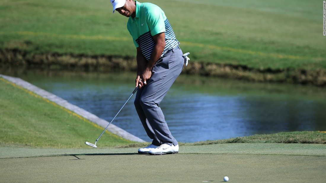 Woods plays a putt at the Players' Championship in Florida in June, where his form took a turn for the better.