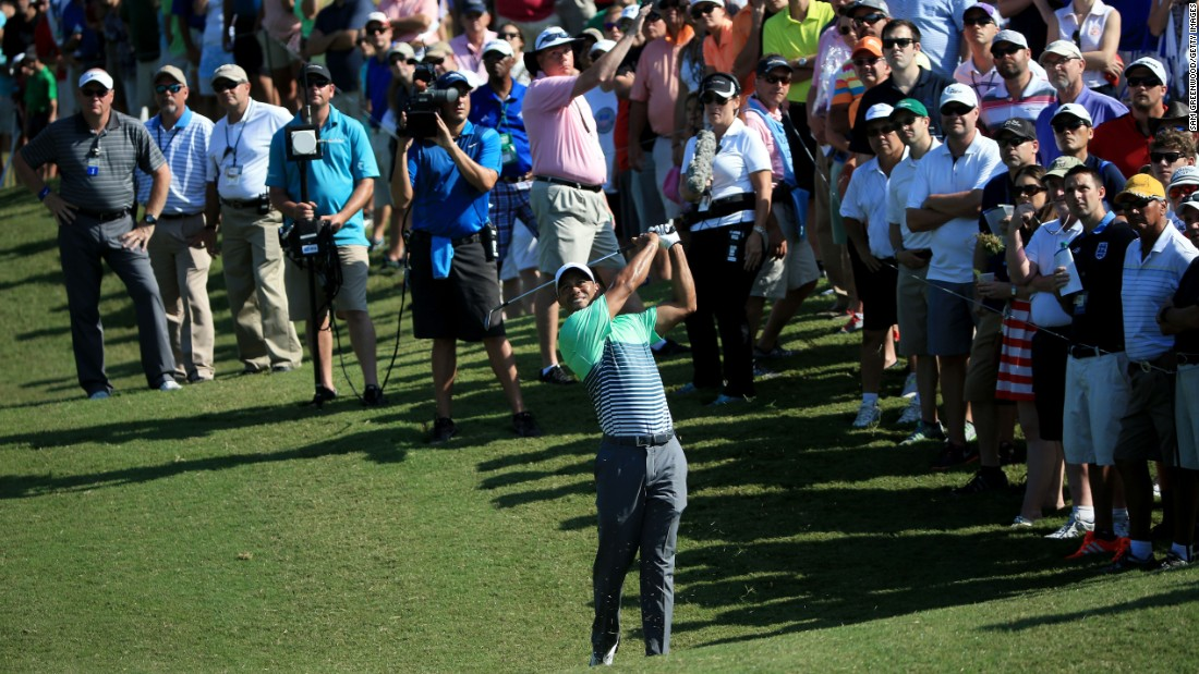 Crowds gather to watch Woods in action at the Players Championship.