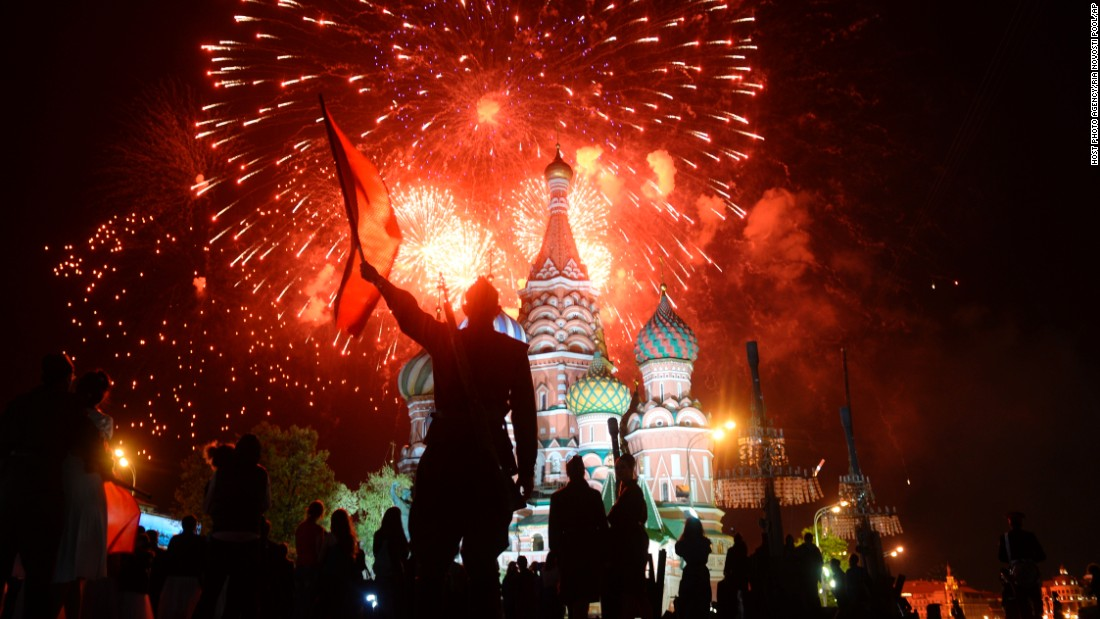 Actors dressed in World War II-era Soviet uniforms watch fireworks over St. Basil Cathedral in Moscow's Red Square on Saturday, May 9, after a concert marking the 70th anniversary of the defeat of Nazi Germany.