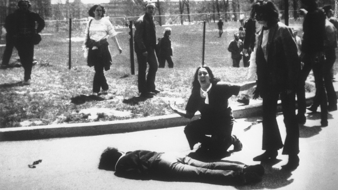 Four students died and nine others were wounded on May 4, 1970, when members of the Ohio National Guard opened fire on students protesting the Vietnam War at Kent State University in Ohio. In this Pulitzer Prize-winning photo, taken by Kent State photojournalism student John Filo, Mary Ann Vecchio can be seen screaming as she kneels by the body of slain student Jeffrey Miller.